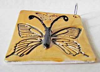 Butterfly stamp side view